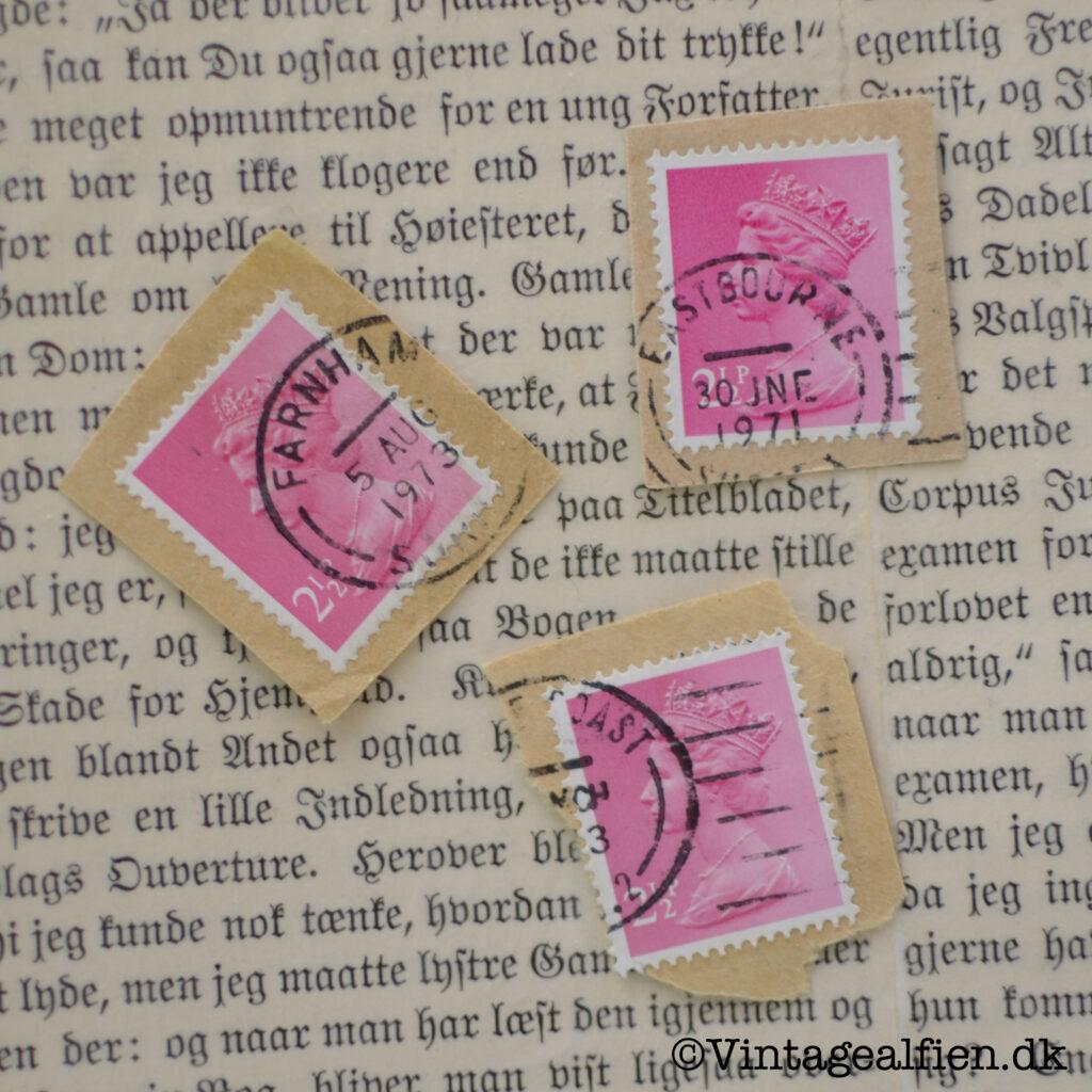 Lyserøde frimærker med tydelige stempler